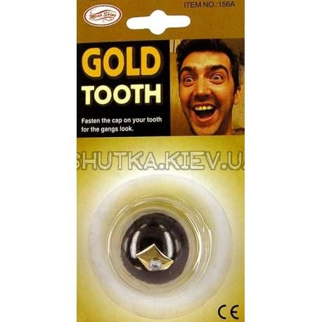 Золотой зуб с брюликом